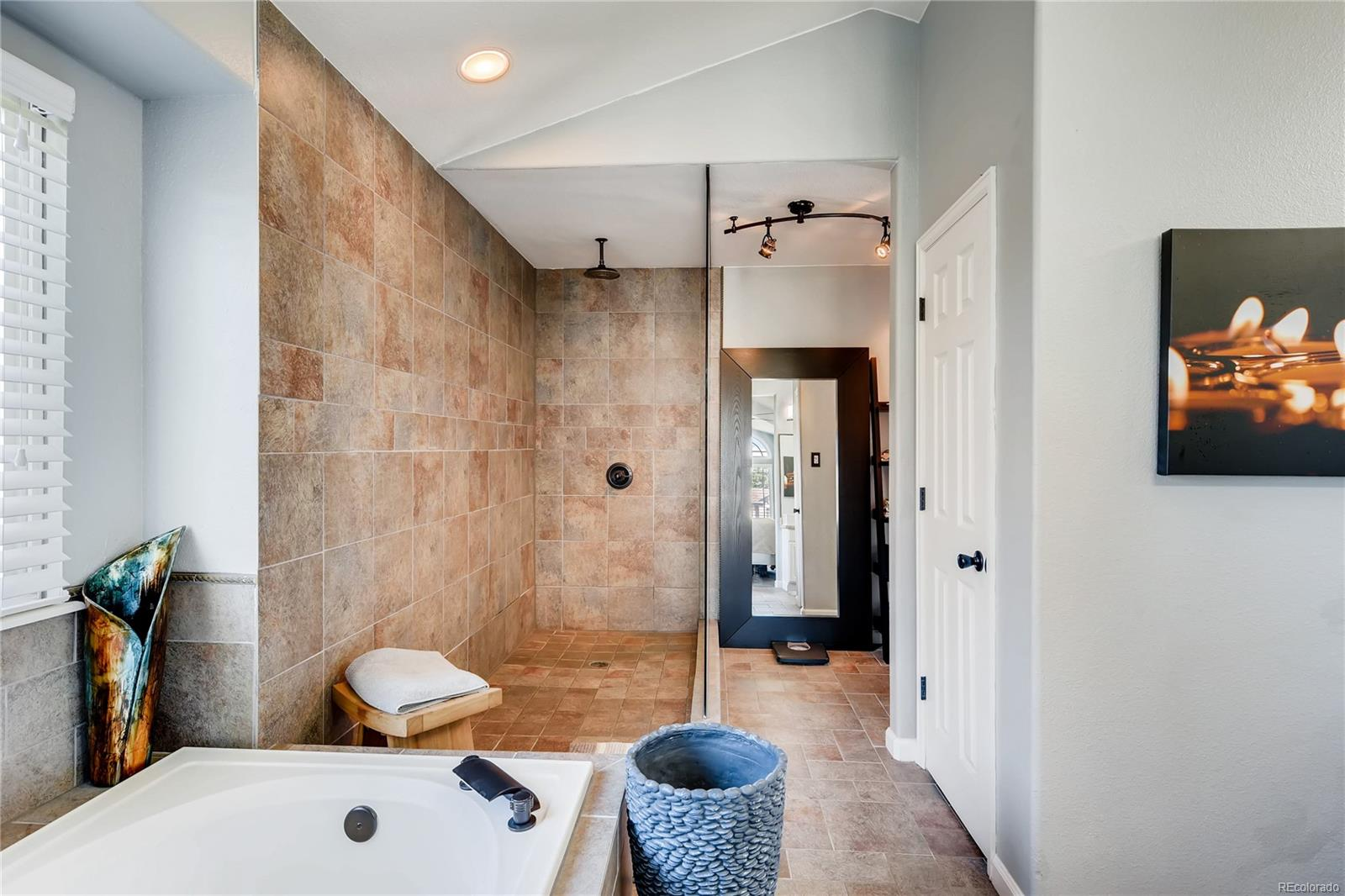 There is no bathroom like this! The 50 sq ft shower is an incredible remodel feature that sets this hone apart. The private toilet is behind the door on the right.