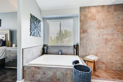 You can soak in this large tub with waterfall faucet for days!