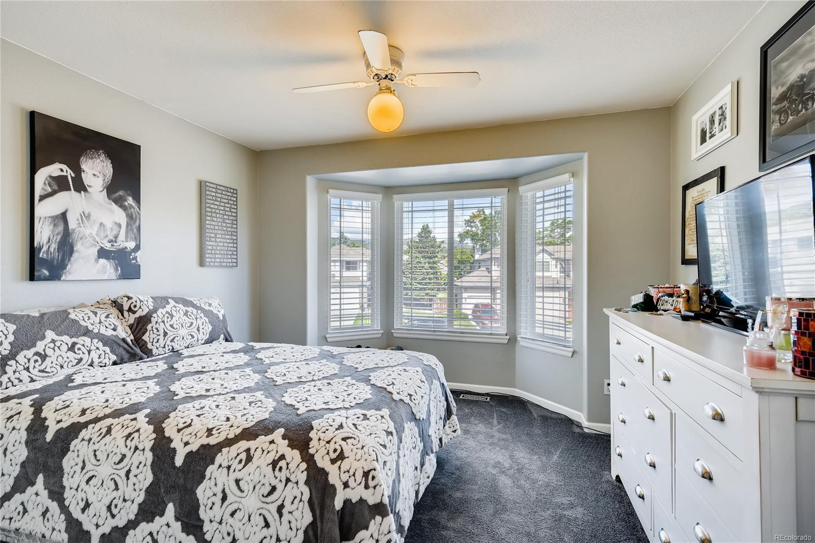 Bedroom #2 in the front of the home with a neat bay window.