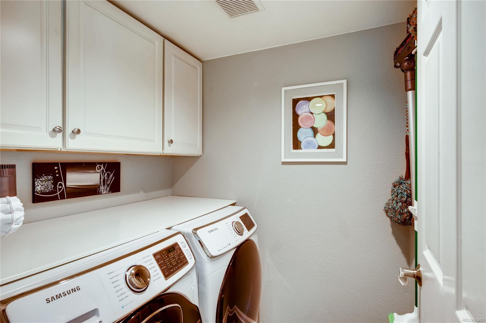 The laundry room is on the main level off the garage entrance. You have space to fold your laundry and store your supplies.