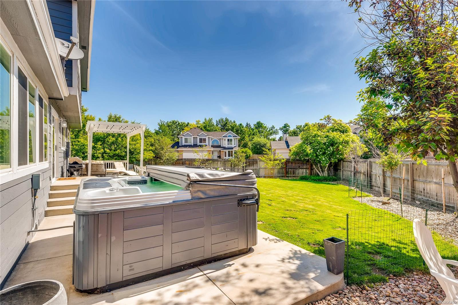 The back yard is a wonderful place to unwind, relax and gather.  Picture relaxing in this hot tub after a hard days work!