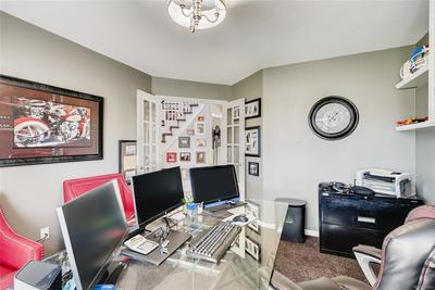 From the den, you have a great view of the entry of the home.