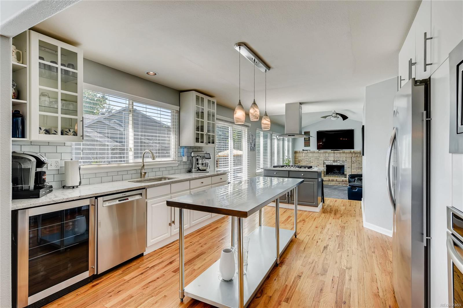 The tile back splash along with the white and grey colors provide a clean setting. The white baseboards are a nice touch throughout the home.