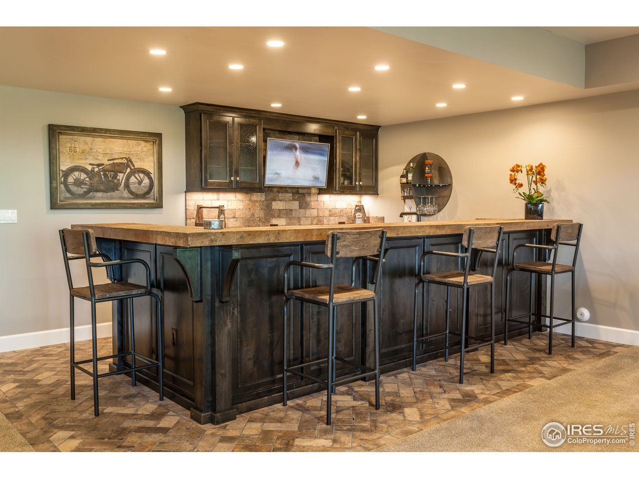 Photo of previously built home--basement bar