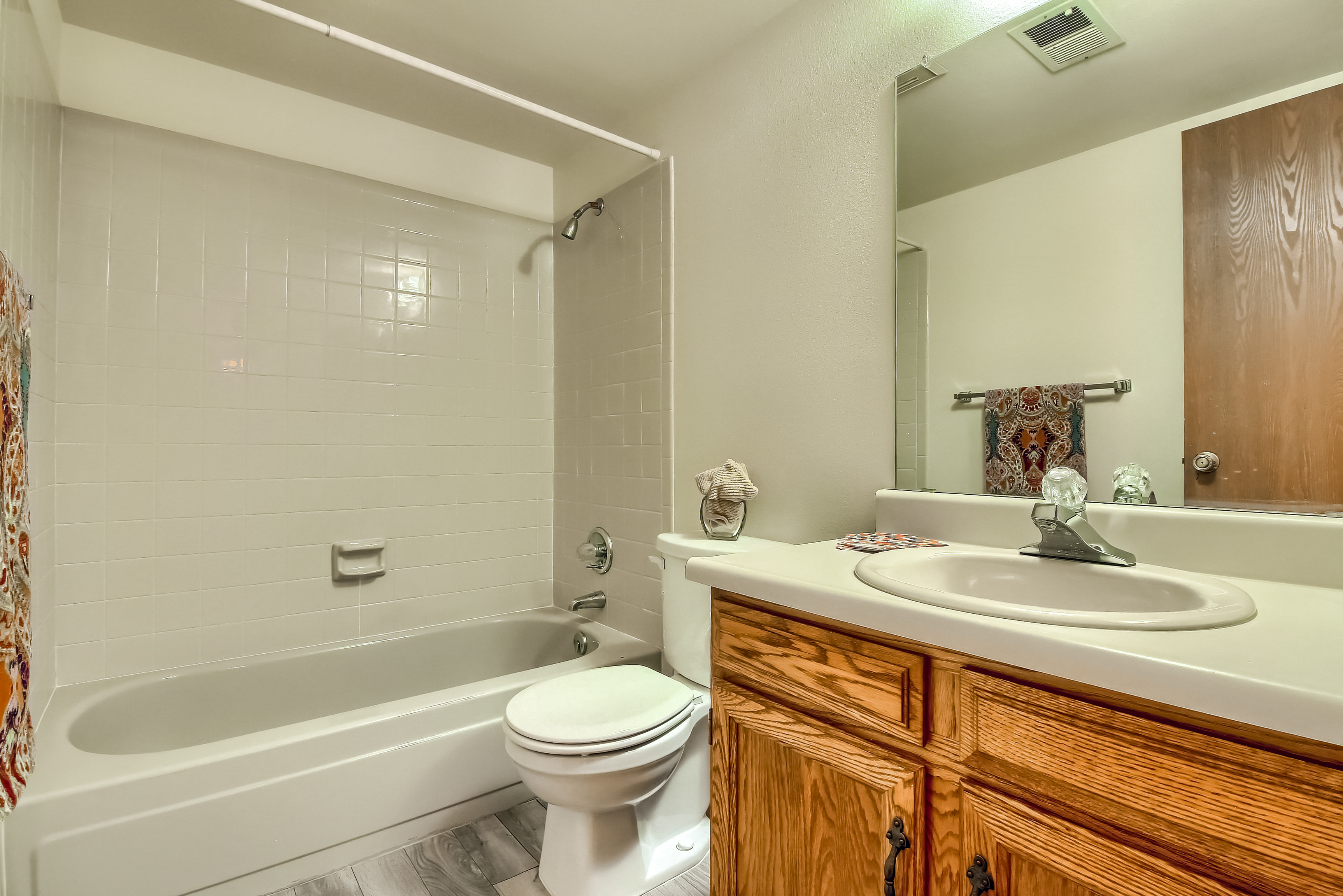 Full Bathroom with Large Mirror and Tub