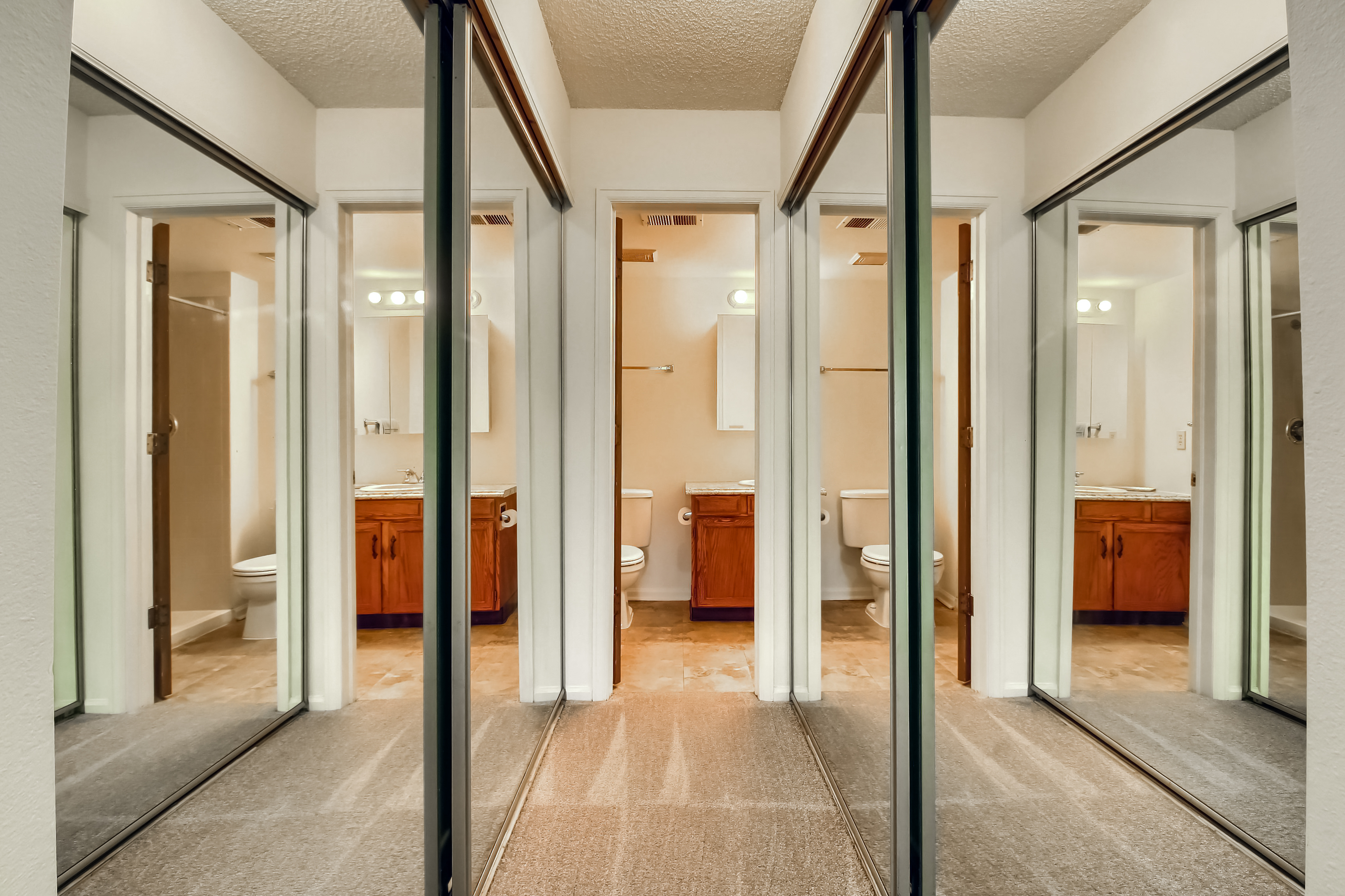Dual Closets with Updated Mirror Doors