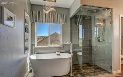 Luxurious Soaking Tub W/ Walk-In Tiled Shower