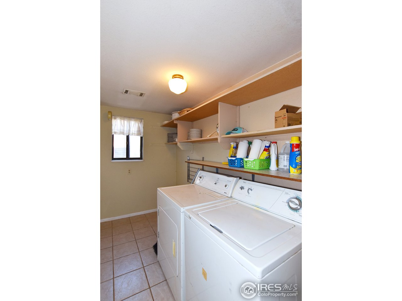 Laundry Room between levels & just off Garage