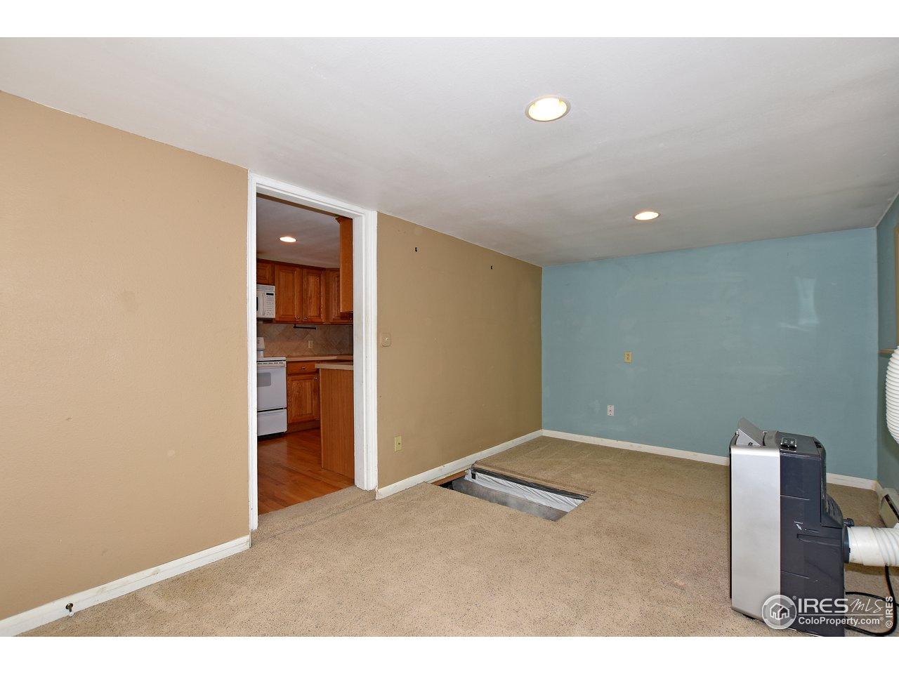 Trap door to tons of standing room storage & utilities