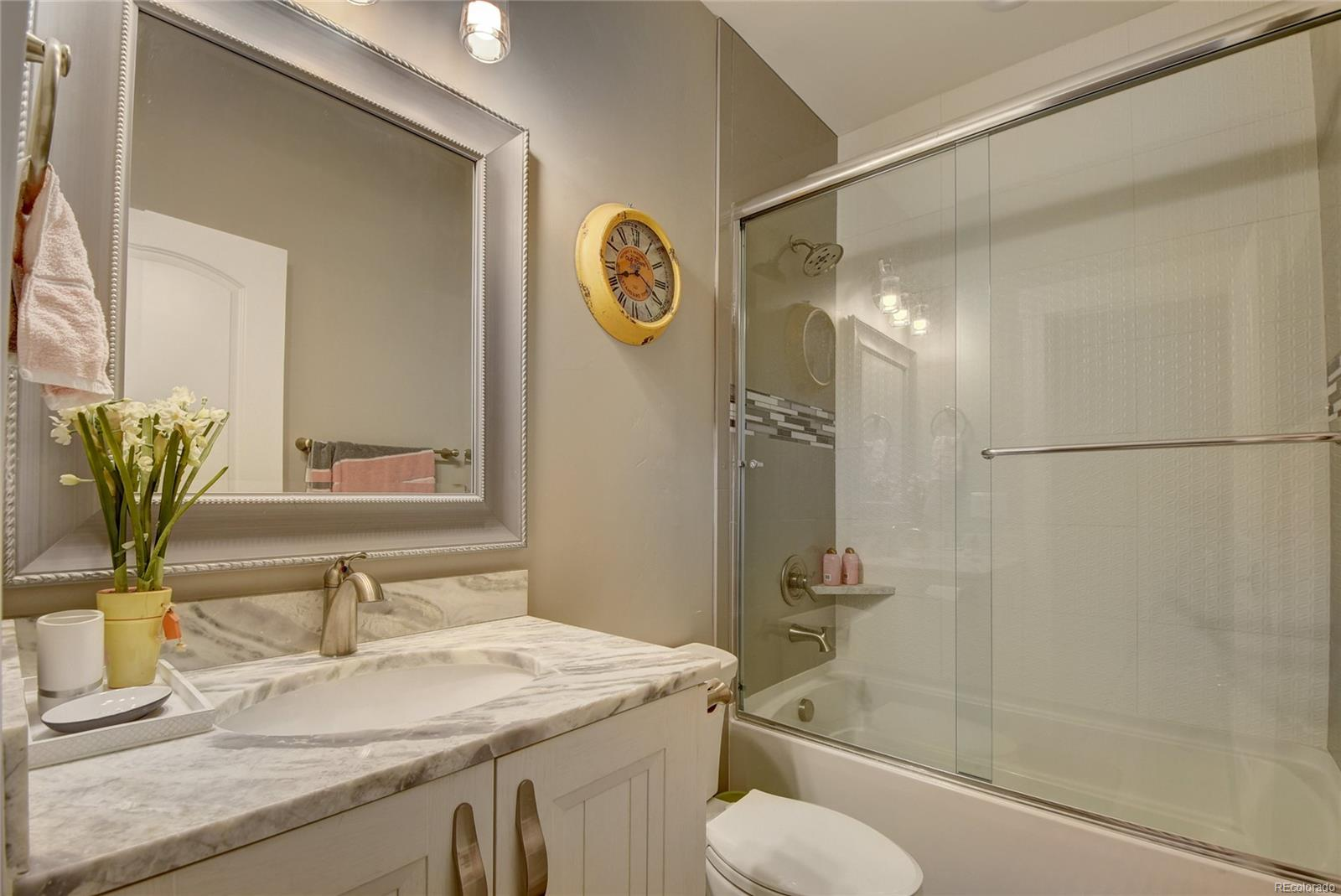 Private full bath in main floor guest suite.