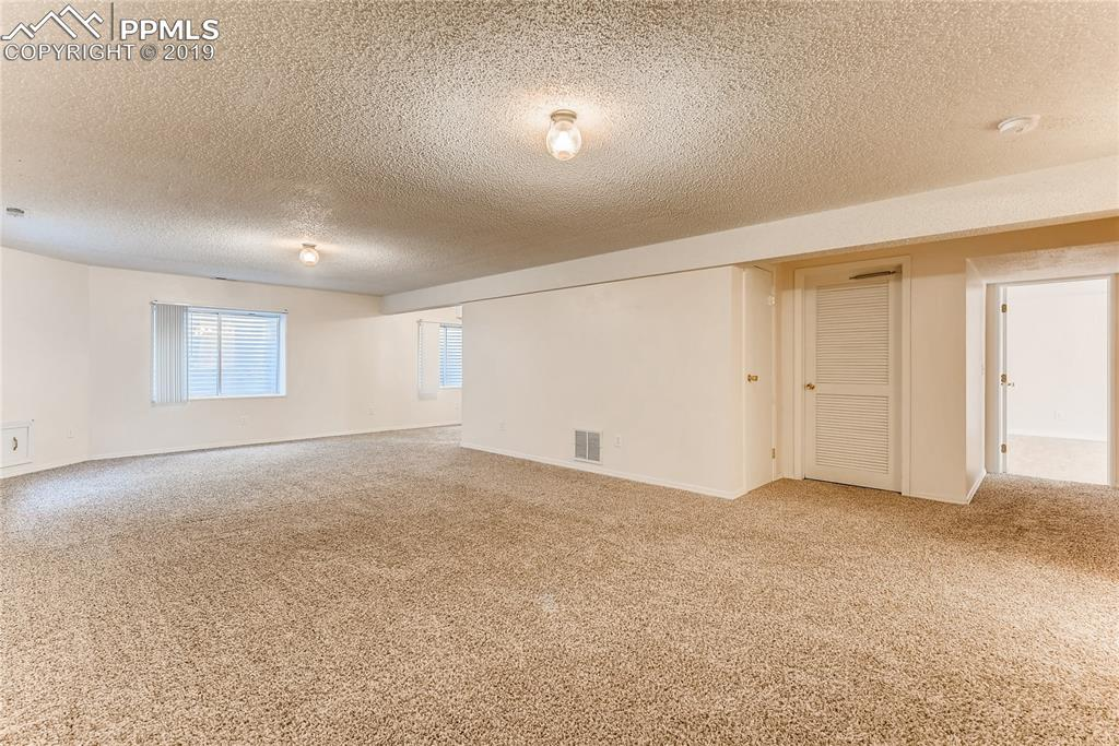 ...and plenty of space for TV viewing and playing games, storage and a nook area for a desk.