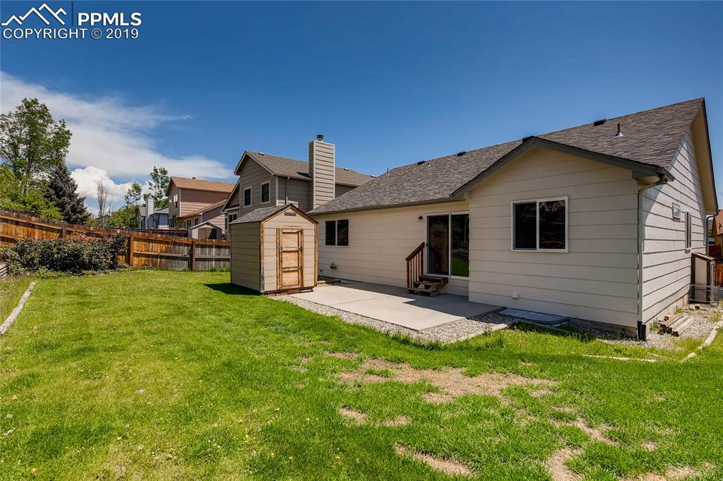 Newer 50-year hail-resistant shingle roof and fully fenced back yard with a storage shed.