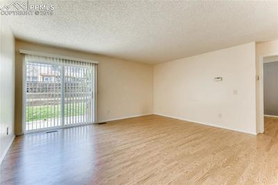 Walk-out from the living room to enjoy outdoor living and the safety of the fully fenced back yard.