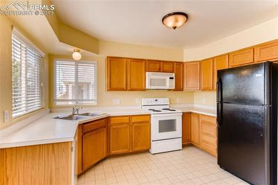 Lots of elbow room in this kitchen and refrigerator included!