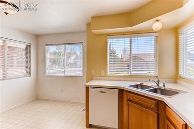 Kitchen features abundant natural light.