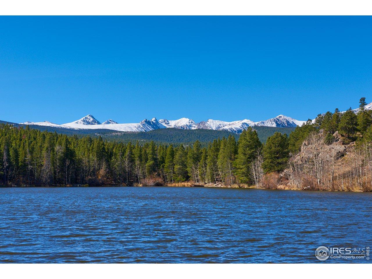 Dramatic mountain views from large alpine lake