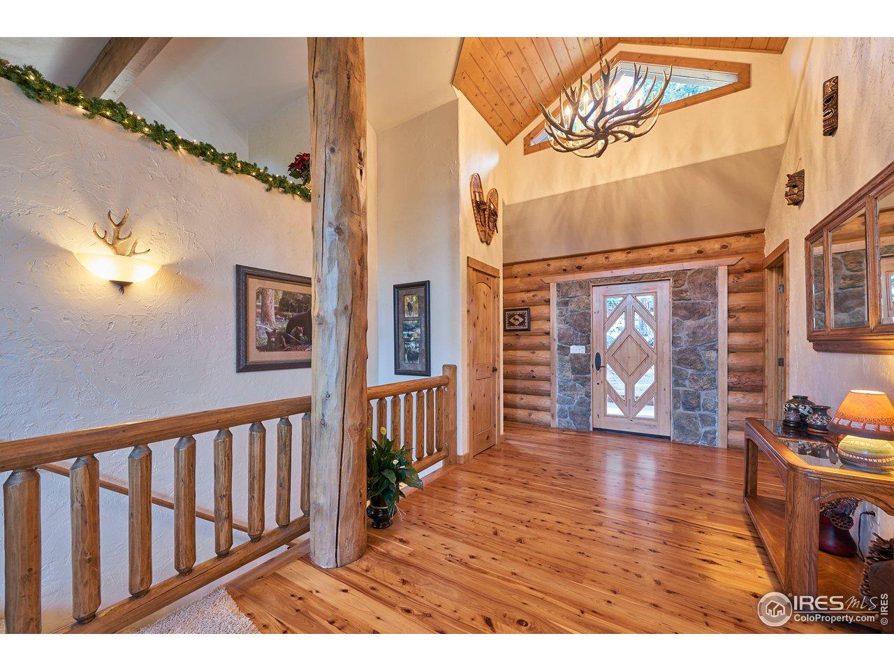 Formal entry w/ vaulted ceilings & Cypress floors