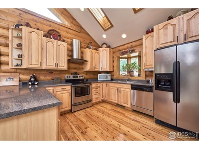 SS appliances and Hickory cabinets