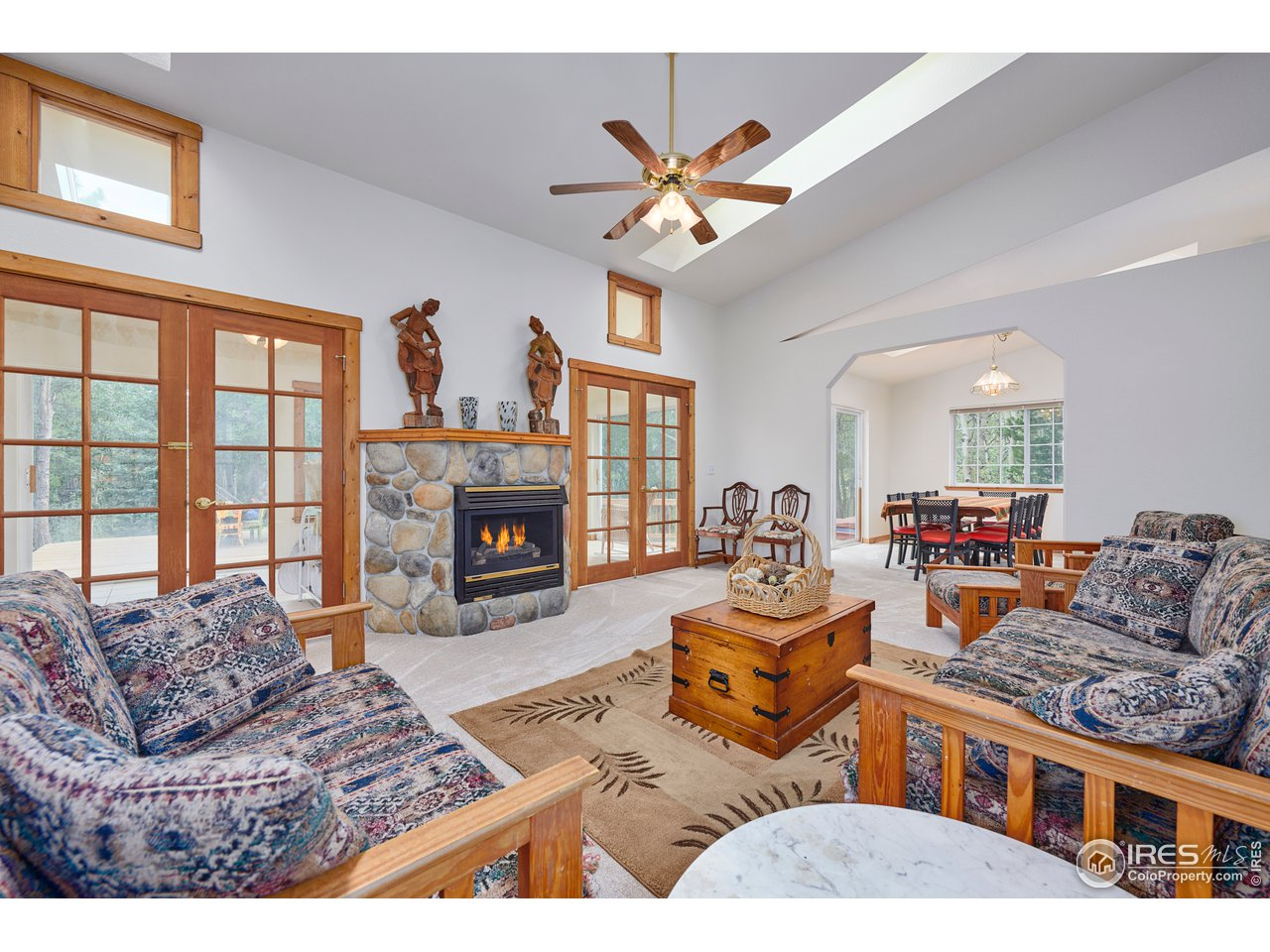 Living room with NEW skylights & gas fireplace