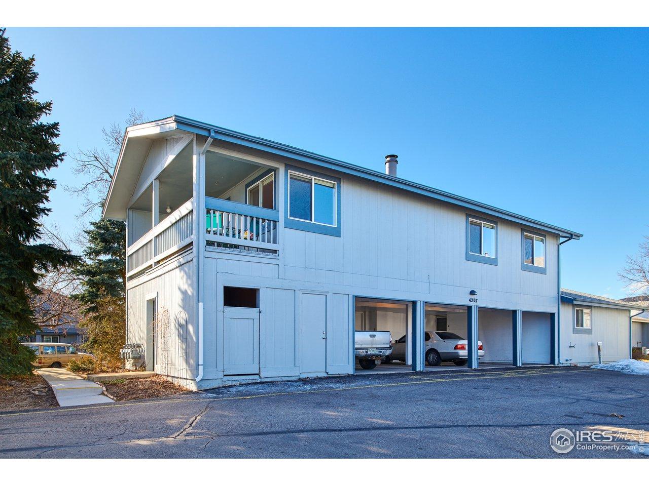 2nd floor unit w/ carport & storage space