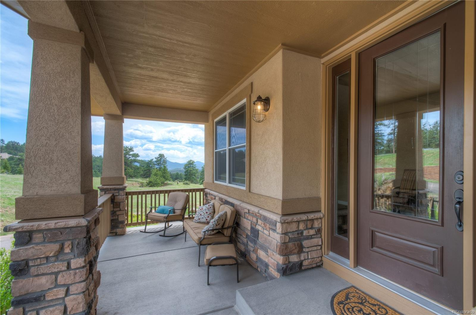 Enjoy The Views From Your Covered Front Porch
