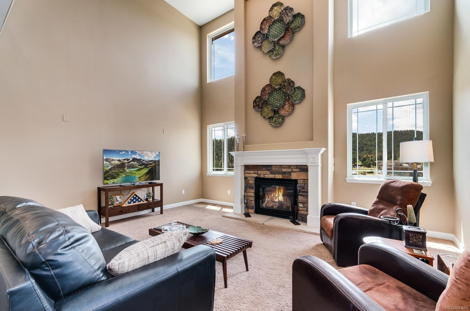 Captivating Mountain Views From Vaulted Family Room with Portrait Windows