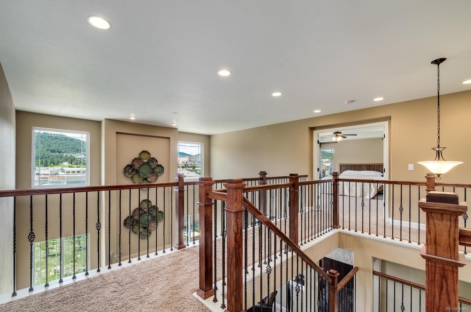 Wide Second Floor Landing with Private Master Suite From Secondary Bedrooms