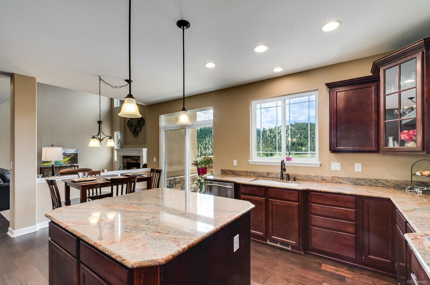 Upgraded Chef's Kitchen with Custom Cherry Cabinets and Slab Granite