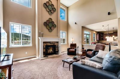 Open Floor Plan Family Room and Kitchen Concept with Gas Fireplace