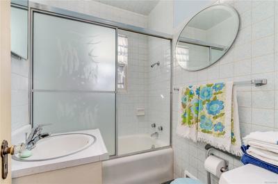 Main floor bathroom offers a hardwood vanity and medicine cabinet.