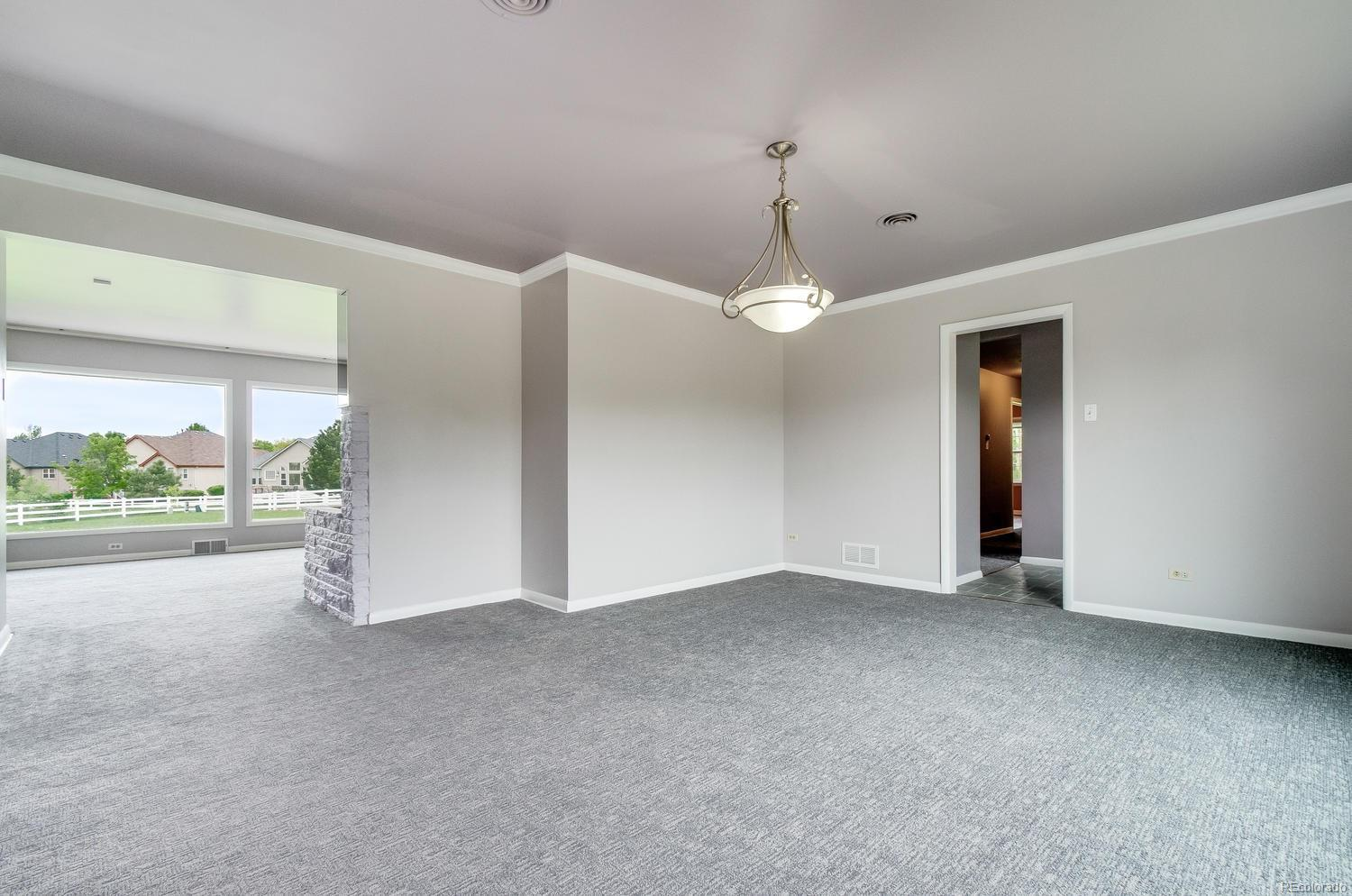 Formal Dining Room w/ Easy Access to the Kitchen