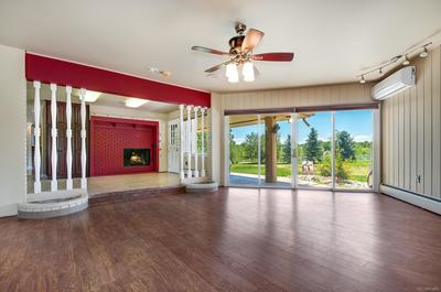 Family Room w/ Indoor Outdoor Living and Room Air Conditioner