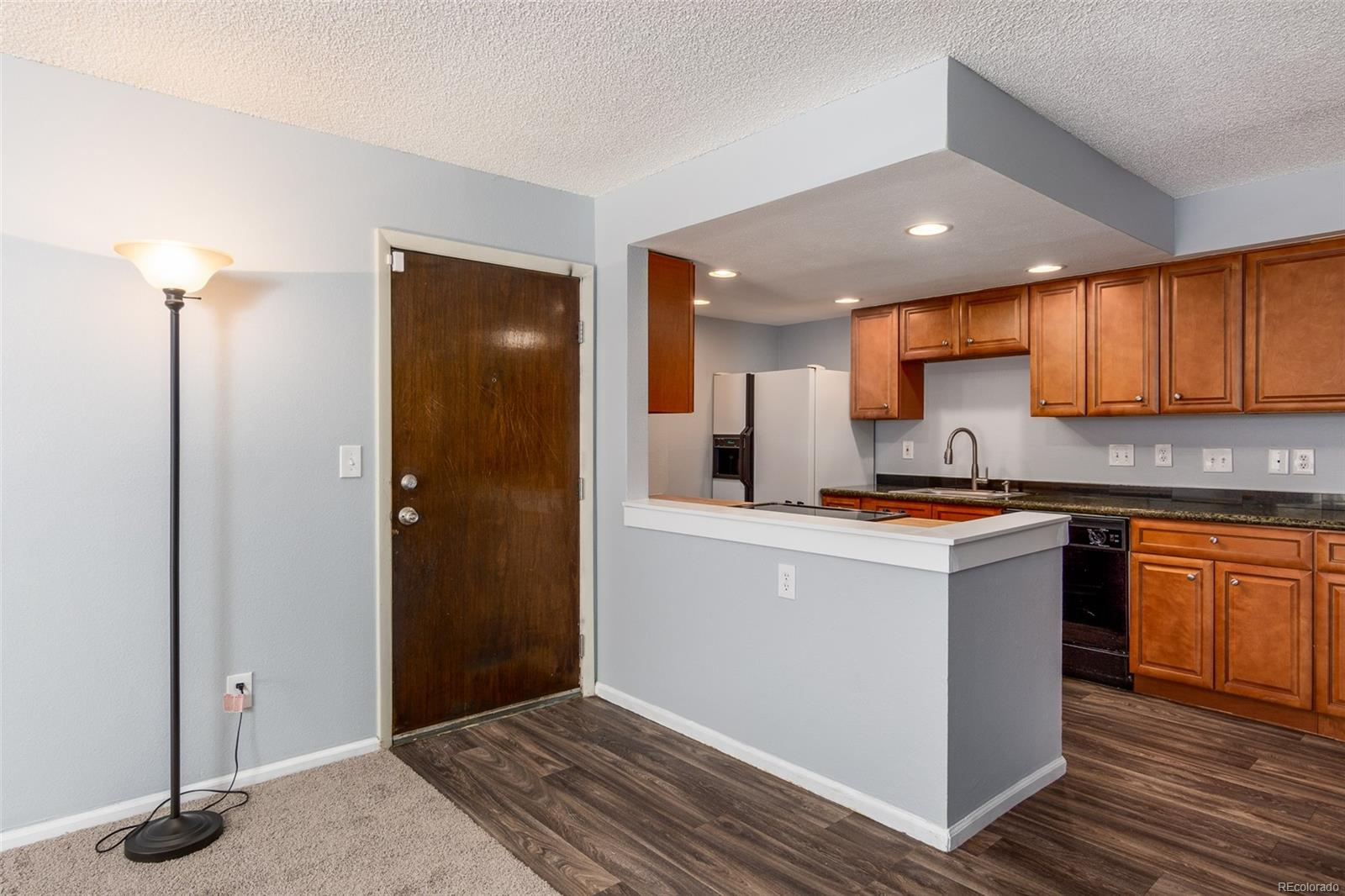 Remodeled Kitchen with New Stove/Oven Flooring, Butcher Block & Granite Counters