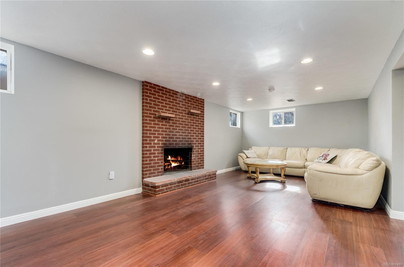 Finished Basement Rec. Room with Hearth Fireplace
