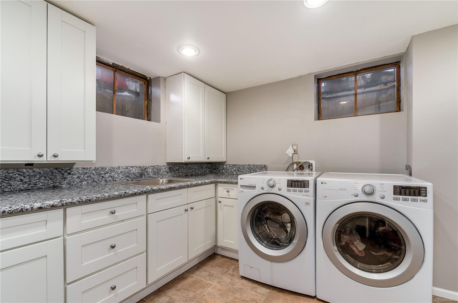 Laundry Room with Built-in Cabinets and Granite Counters