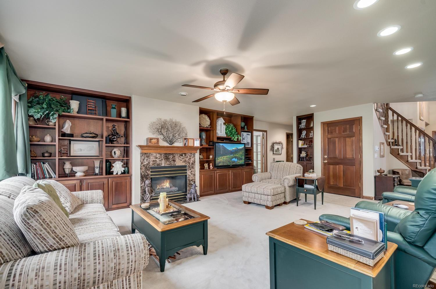 Hardwood built-ins and gas fireplace make the family room perfect for movie nights!