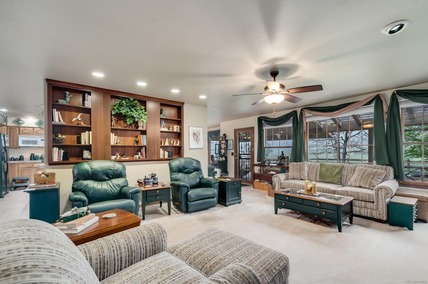 Large windows offer plenty of natural light as well as a view of Green Mountain!