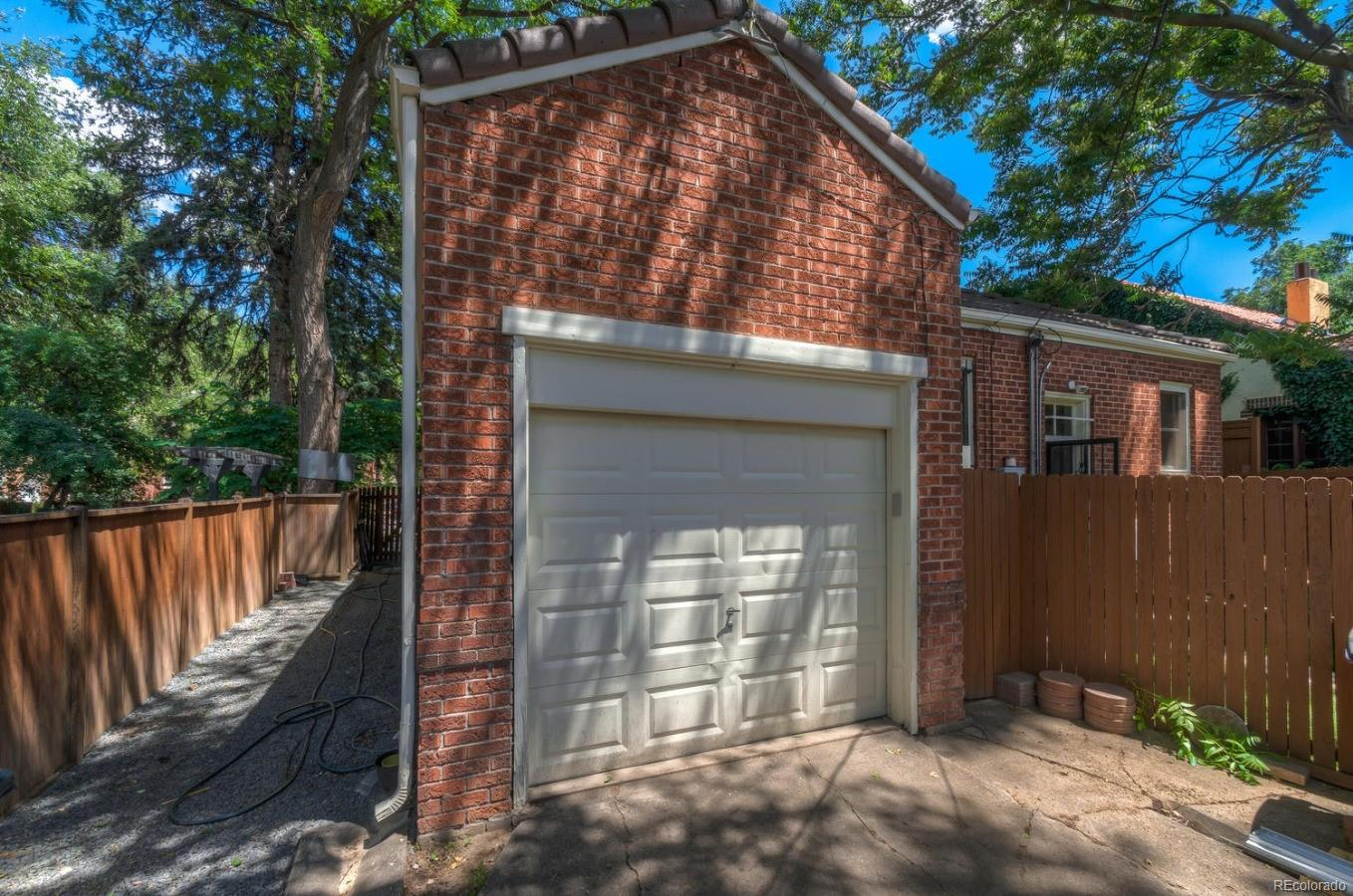 1 Car Detached Garage accessed by alley.
