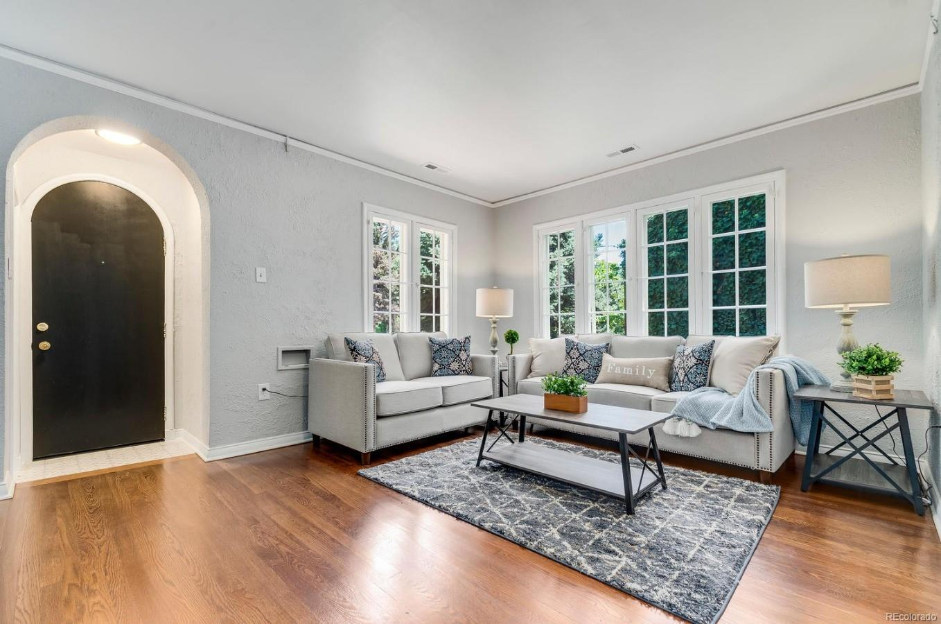 Arched entry welcomed into bright Living Room.