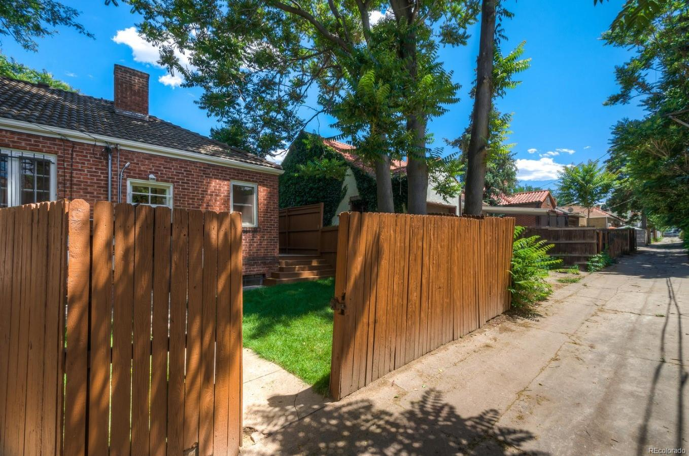 Fenced yard with gate to back alley.