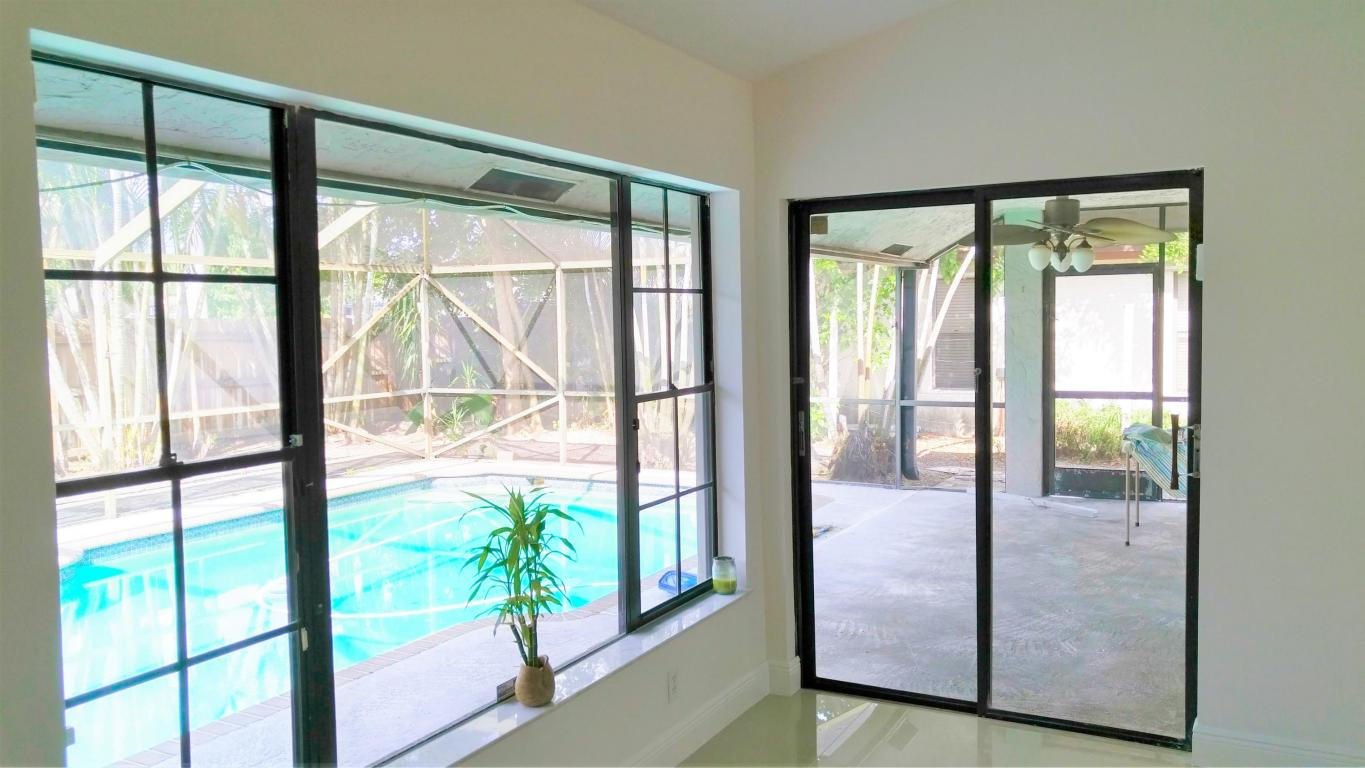 Living Area to Pool and Covered Patio