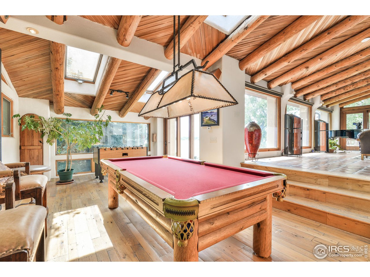 Separate den/pool area with wet bar