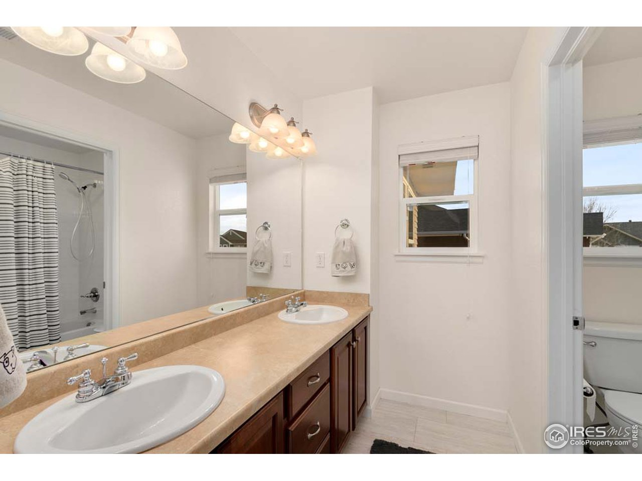 Full bath with double sinks