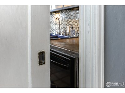 Pocket door to kitchen