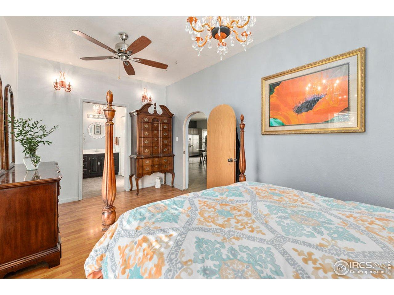 Primary suite with vintage arched doorway