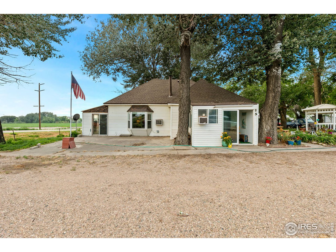 Mature trees, plenty of parking, and a large patio on the east side welcome you to 13707 Hwy 14.