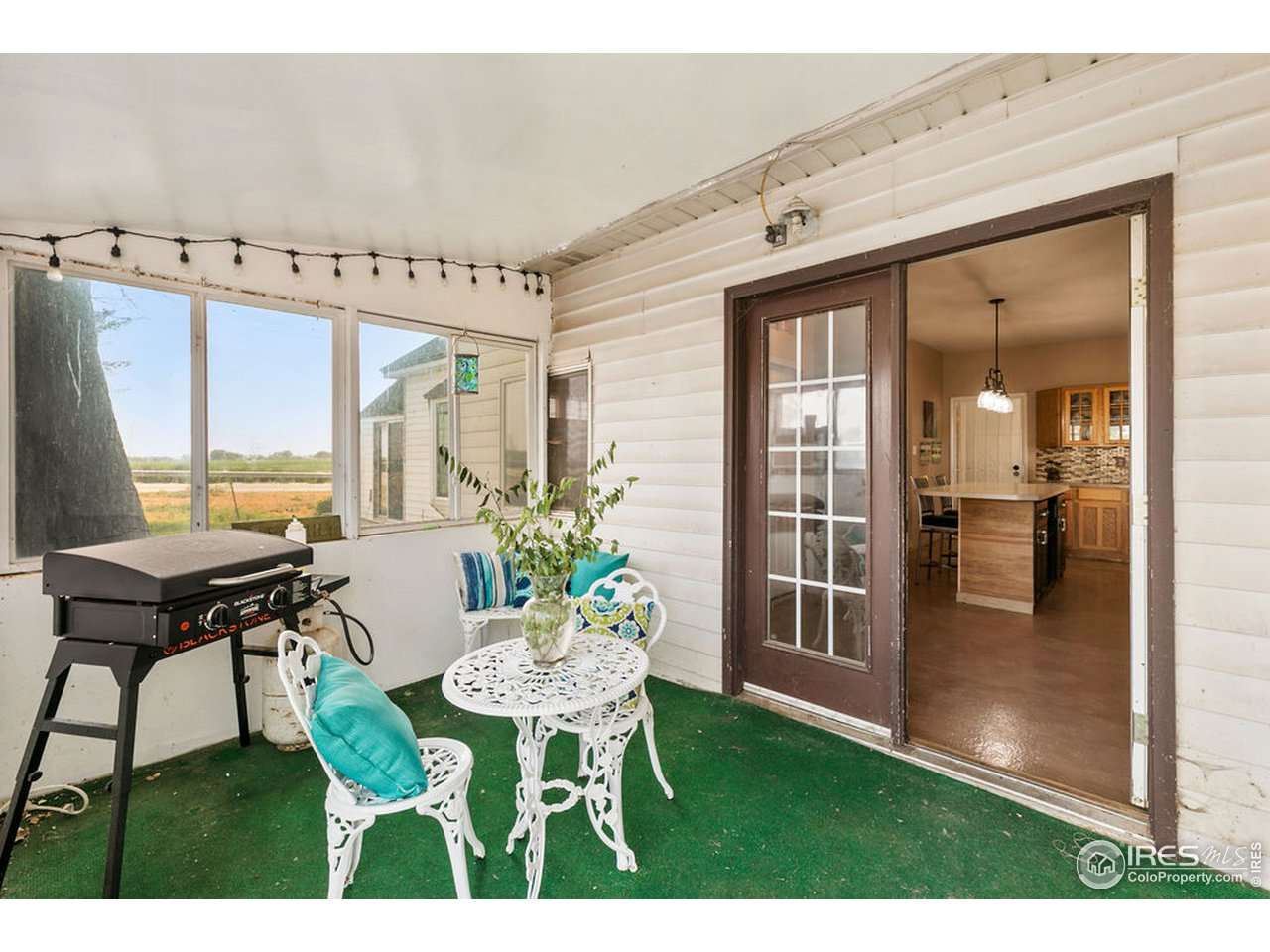 Just off the kitchen is a nice covered patio and the main entrance to the home.