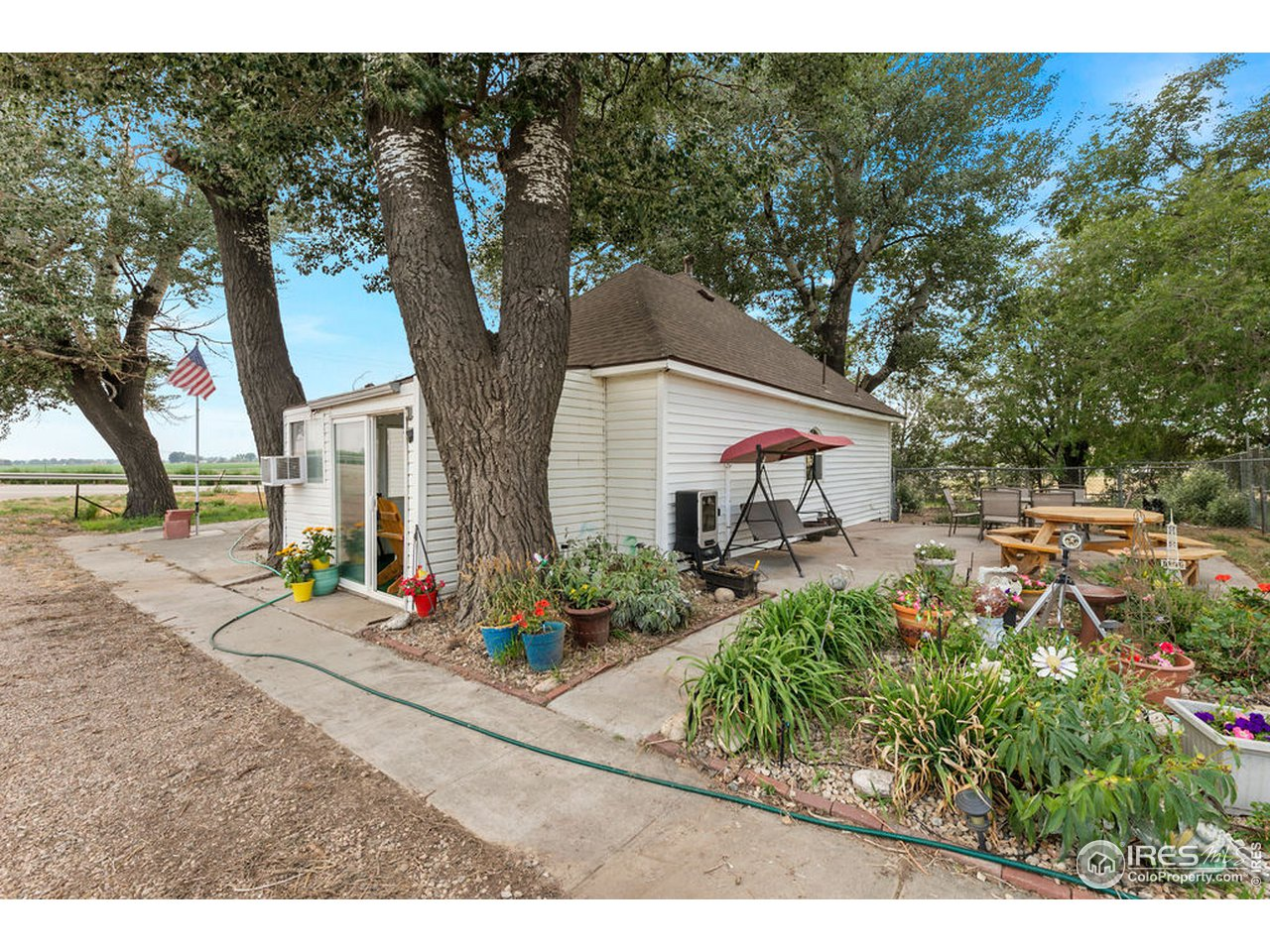 Out back on the north side you will find another shady patio and a nice flower garden.