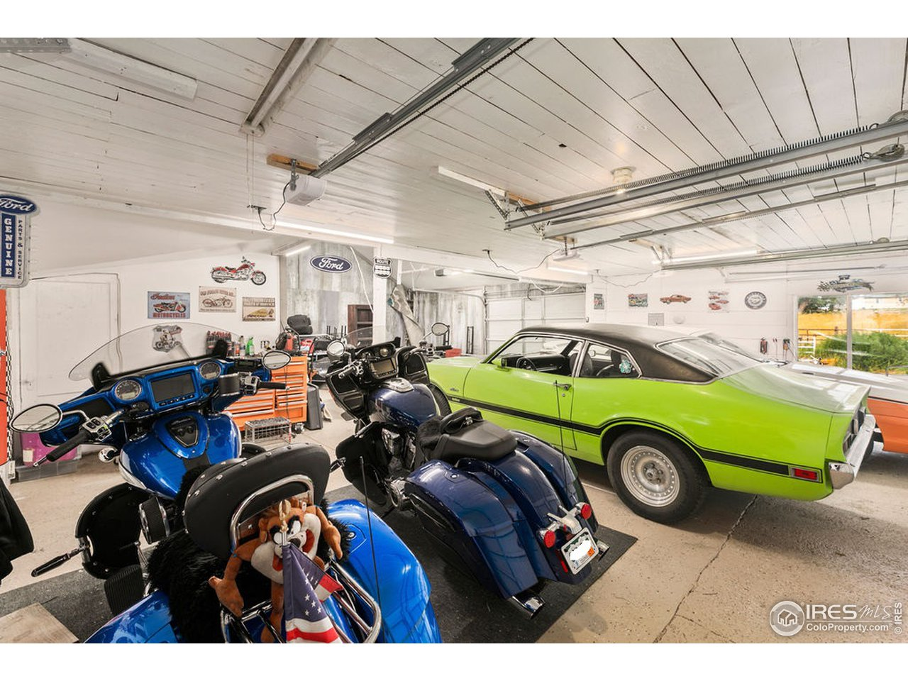 Bright and well-lit garage with storage.  Newer openers on overhead doors.