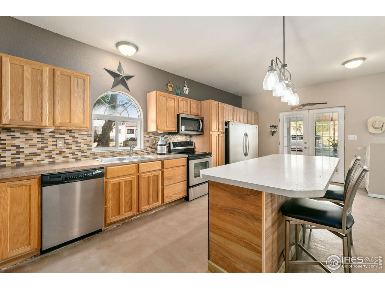 Step inside to the newer kitchen with oak cabinets, stainless appliances, a big island and a commercial size refrigerator and freezer.